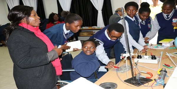 Mrs. Jacinta Akatsa-HSC, Director CEMASTEA joins MaryHill Girls' High School Form Four C, the best class, 2019 at the Centre's Innovations Lab during their visit